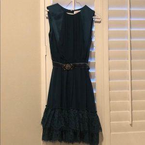 Dark teal dress.